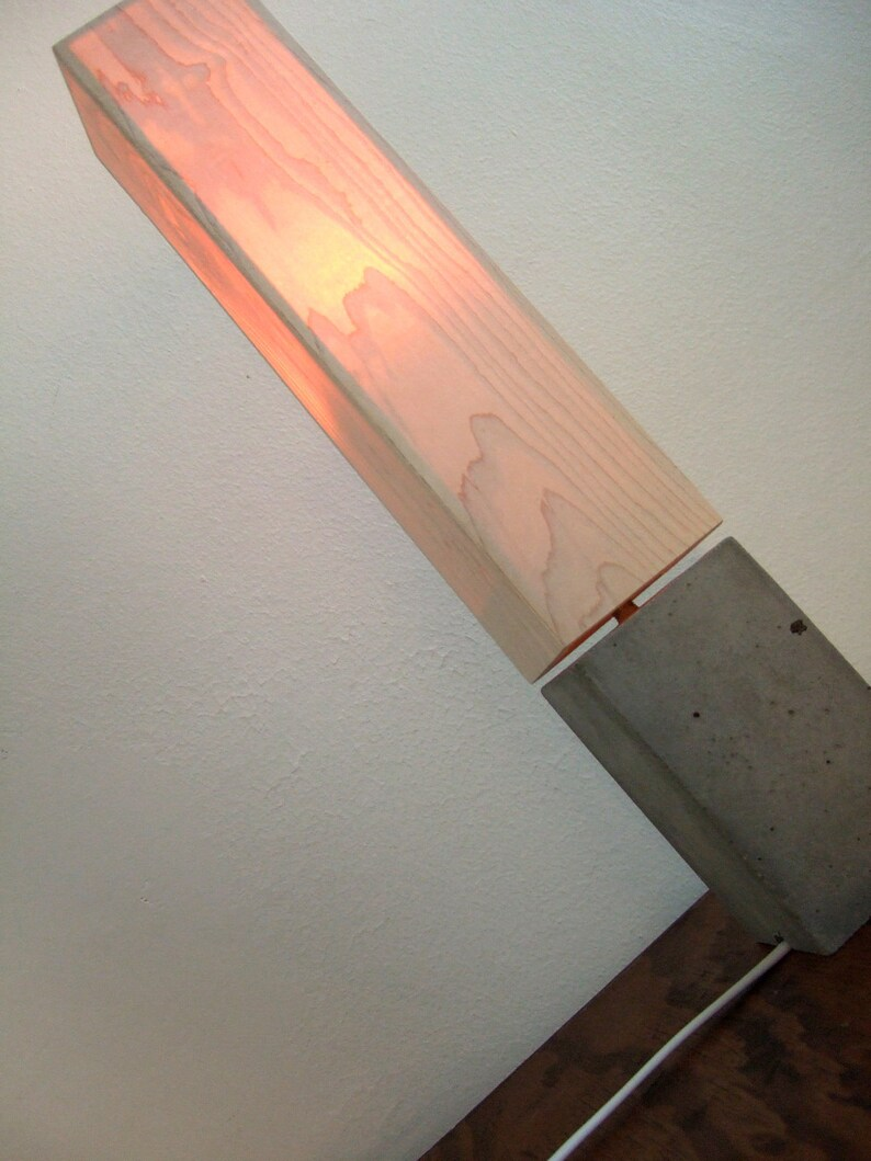 petite concrete table lamp with wood veneer lampshade.