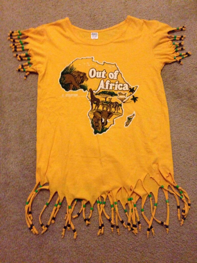 777a77d9e Vintage amarillo flecos África vida silvestre vestido túnica | Etsy