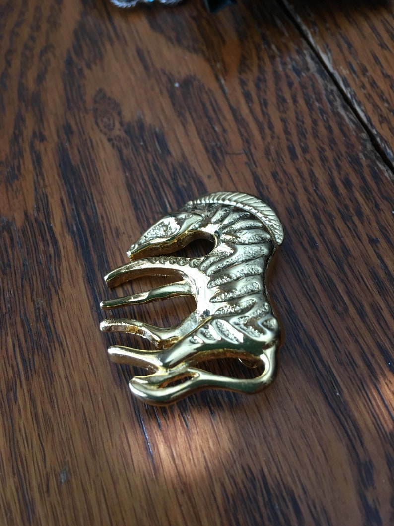 Zebra mint condition  1980/'s gold tone roll clasp gold tone brooch pin