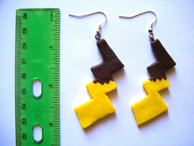 Pikachu tail earrings | Etsy