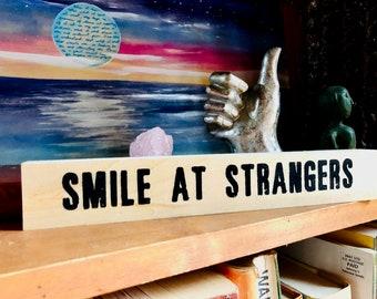 SMILE AT STRANGERS