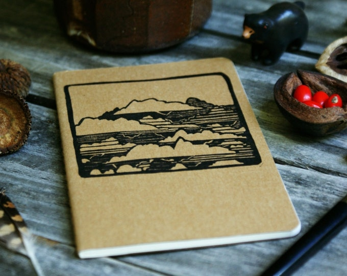 Featured listing image: Clouds in the Sky Brown Notebook Moleskine Journal Hand Carved Camping Nature Cloudy Hiking Trail Camp Travel Journey