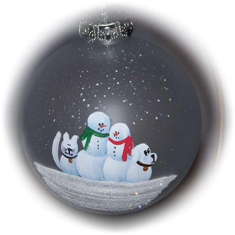Our family with a snow cat and snow dog hand painted on a 3 image 0