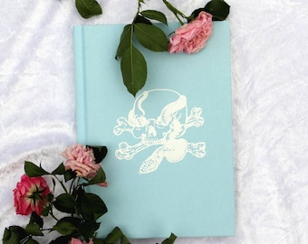 Pastel Goth Notebook, Embossed Skull & Snakes White on Blue. Hard Back, Lined, Ruled, A5, Yumi Kawaii, Creepy Cute