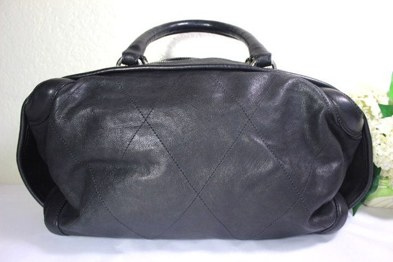 a43248638ecf Vintage Chanel Black Quilted Leather Barrel Duffel Travel Hand