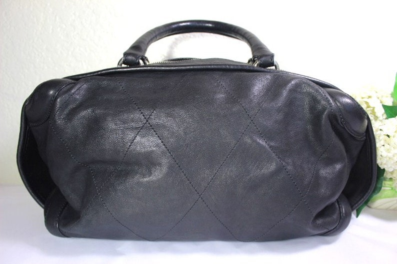 c1f71a0c477a9f Vintage Chanel Black Quilted Leather Barrel Duffel Travel Hand   Etsy