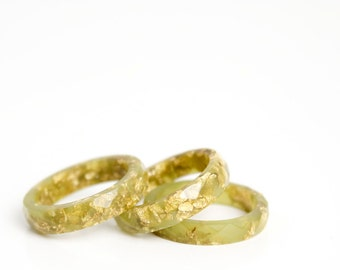 size 7 | thin multifaceted stacking ring | olive green eco resin with metallic gold leaf flakes