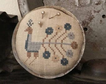 primitive cross stitch BLUE PEACOCK zinc jar lid pin cushion