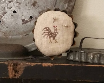 "primitive cross stitch BROWN SPOTTED HEN  2 1/2"" round tart tin pin cushion"