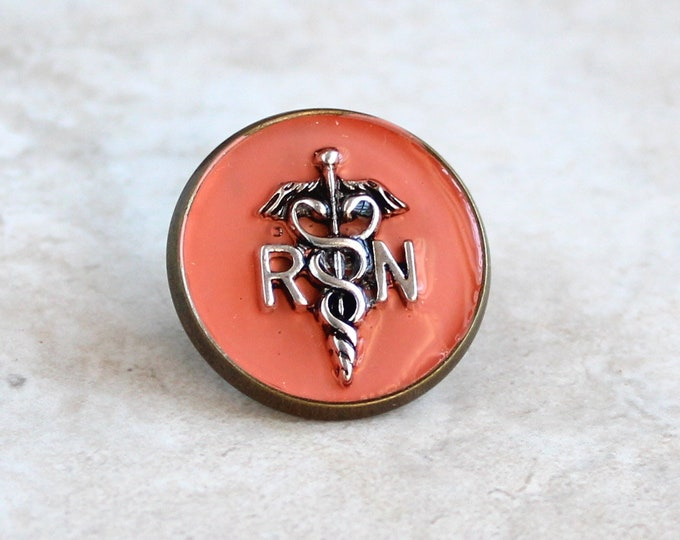 registered nurse RN pin, coral, pinning ceremony