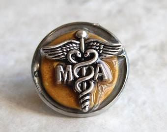 medical assistant pin, dark gold, MA pinning ceremony