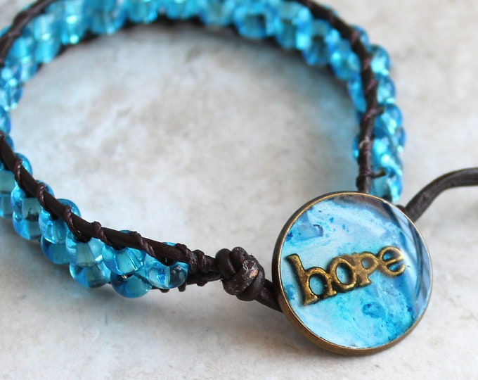 hope inspirational bracelet with leather cord and blue glass beads