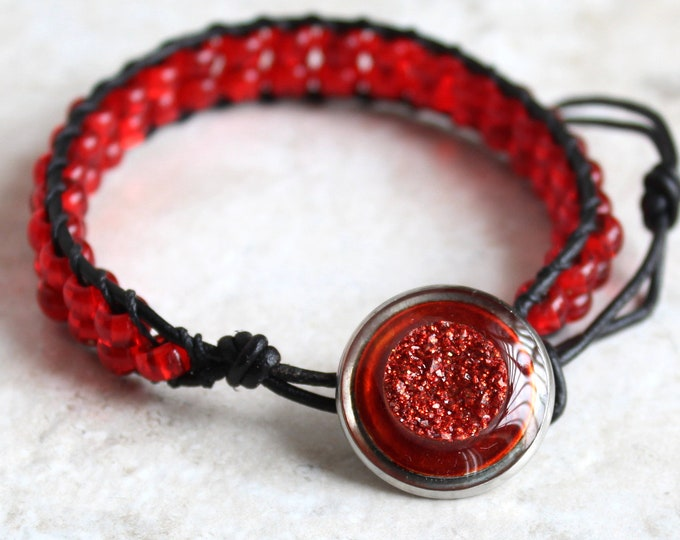 druzy style bracelet with orange / red glass beads and leather cord