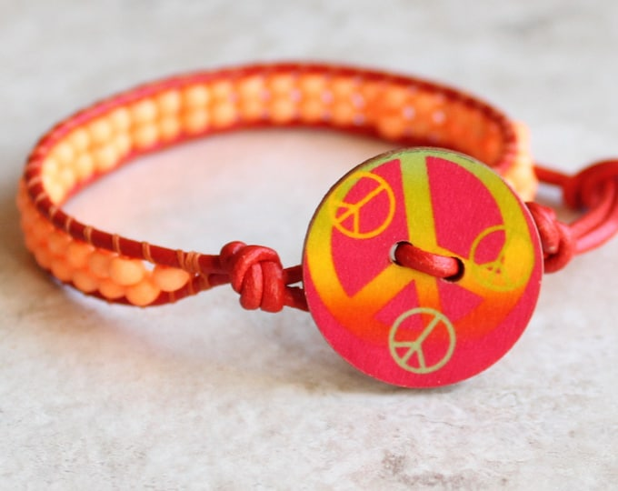 peace sign bracelet with red leather cord and orange glass beads