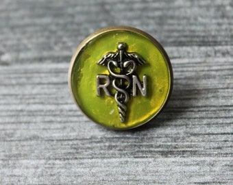 registered nurse RN pin, chartreuse, pinning ceremony, white coat ceremony, RN graduation