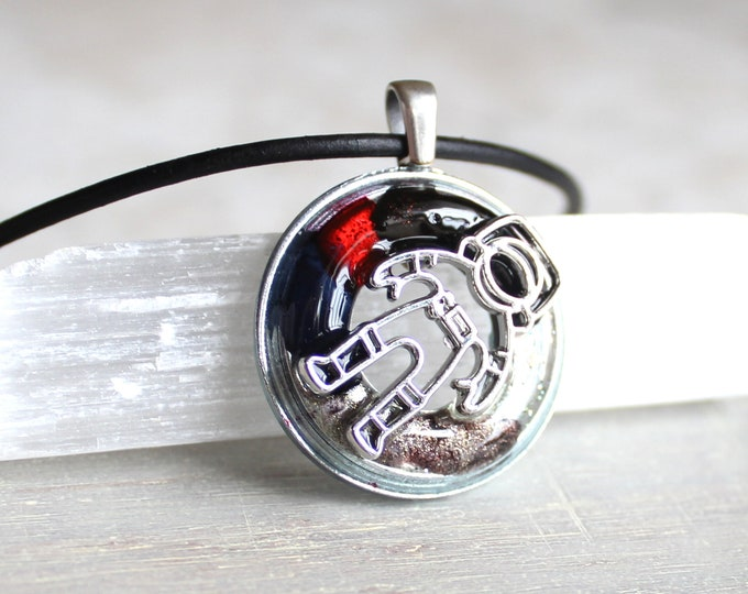 astronaut necklace, spaceman necklace, outer space pendant, explorer necklace, black, red and silver