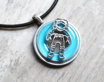 astronaut necklace, glow in the dark