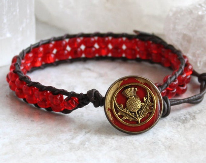Scottish thistle bracelet with leather cord and red glass beads