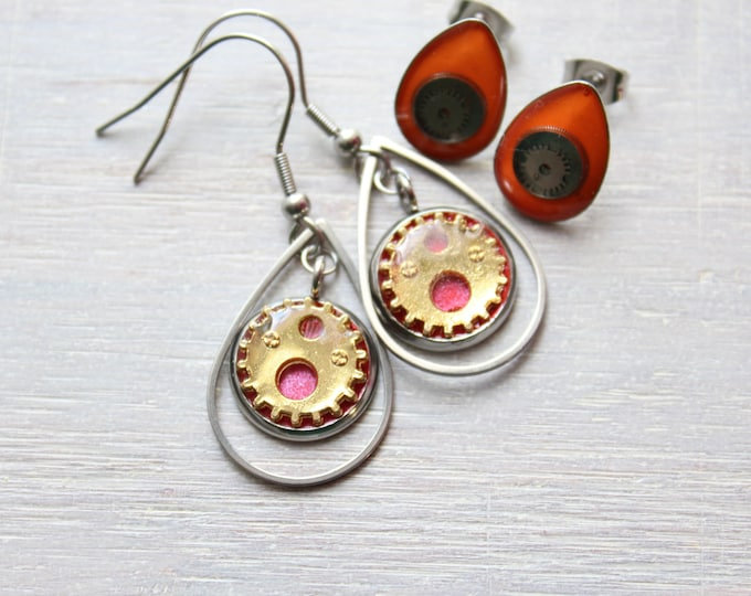 red and gold steampunk earrings on stainless steel ear wires paired with orange watch gear teardrop post earrings