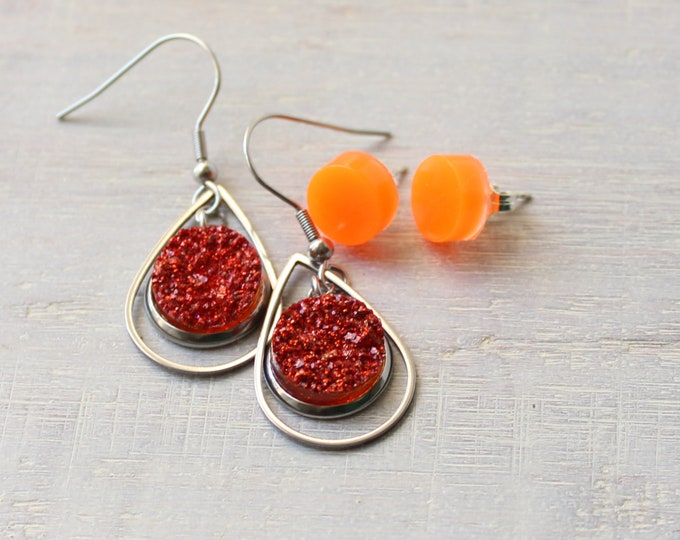 festival style teardrop earrings on stainless steel ear wires and glow in the dark orange dots with sterling silver posts