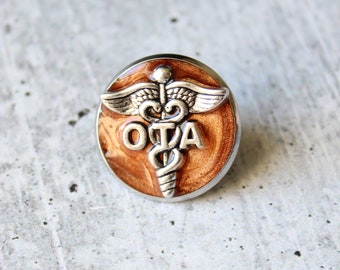 occupational therapy assistant pin, OTA pinning ceremony, white coat ceremony, occupational therapist aide, bronze