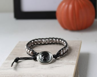 skull bracelet with black crystal skull, Czech glass beads, leather cord