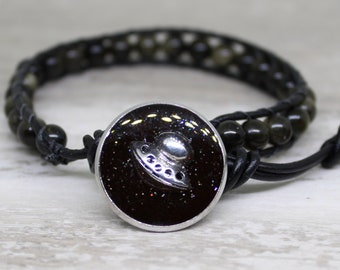 UFO bracelet made with obsidian beads and leather cord