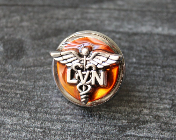 licensed vocational nurse pin, orange, LVN pinning ceremony, white coat ceremony