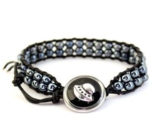 UFO bracelet made with hematite beads and leather cord