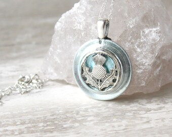 ice blue Scottish thistle necklace on sterling silver chain