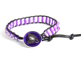 elephant bracelet with purple glass beads and leather cord
