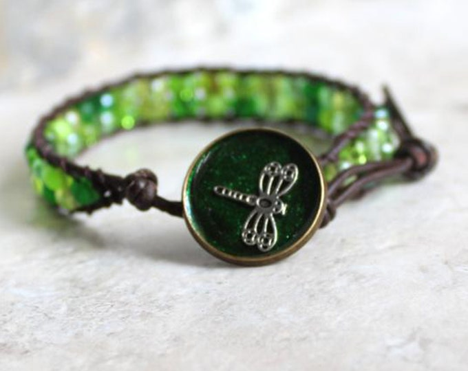dragonfly bracelet with green glass beads and leather cord