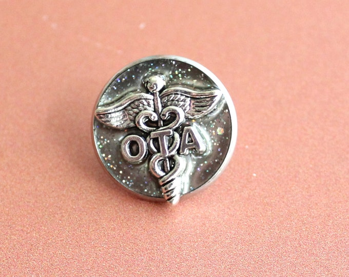 occupational therapy assistant pin, OTA pinning ceremony, white coat ceremony, occupational therapist aide, silver