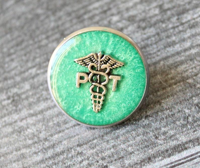 PT pinning ceremony aqua green white coat ceremony physical therapist pin