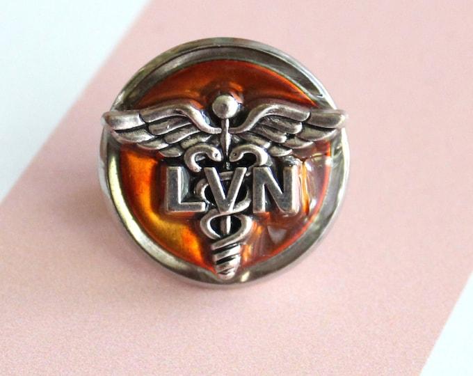 licensed vocational nurse pin, orange, LVN pinning ceremony, white coat ceremony