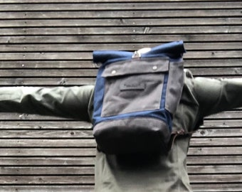 Blue waterproof waxed canvas backpack  medium size with padded shoulder straps and water bottle pocket, unisex collection