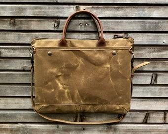 74a2fcfcd6c1 briefcase in waxed canvas and leather with luggage handle attachment on the  back COLLECTION UNISEX