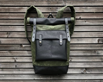 Waxed canvas backpack with roll up top and  leather bottom and outside pocket COLLECTION UNISEX