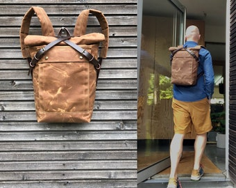 Waterproof backpack medium size rucksack in waxed canvas, with volume front pocket and double layered bottom
