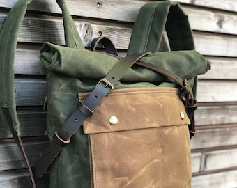 olive green backpack medium size rucksack in waxed canvas, with volume front pocket and double layered bottom
