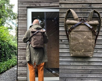 Field tan backpack medium size rucksack in waxed canvas, with volume front pocket and double layered bottom