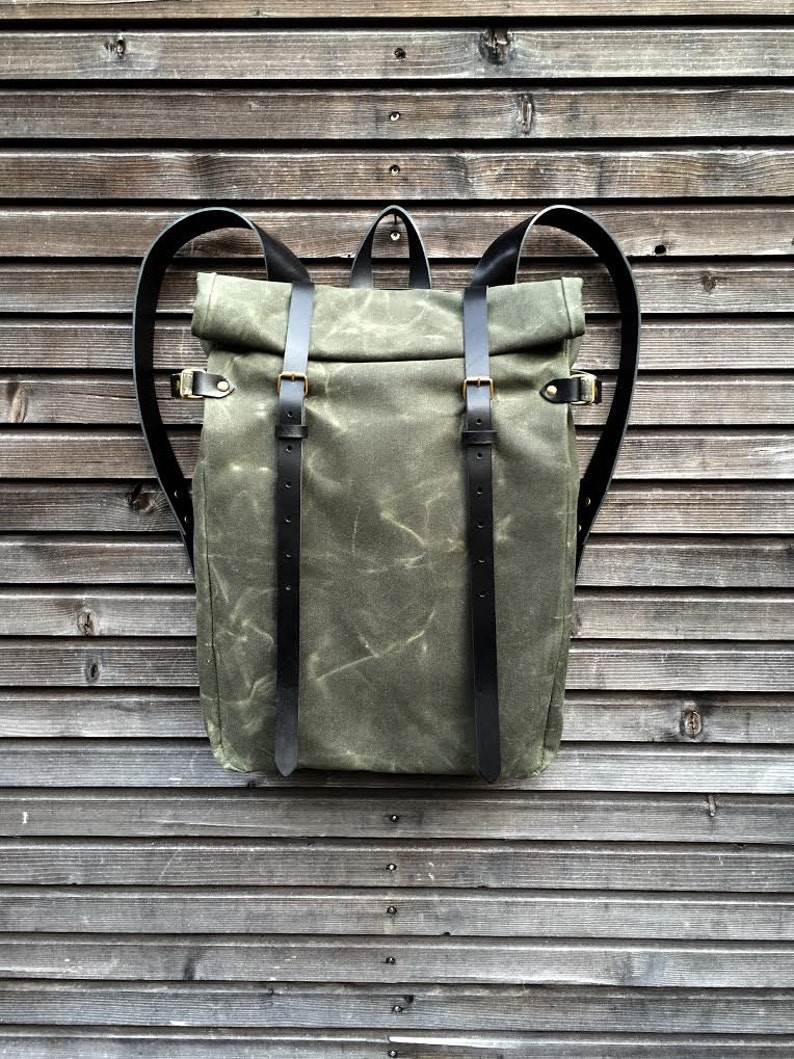 Green waxed canvas backpack with roll to close top and image 0