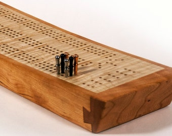 Cribbage Board - Continuous track with peg and card storage. Figured maple and cherry.