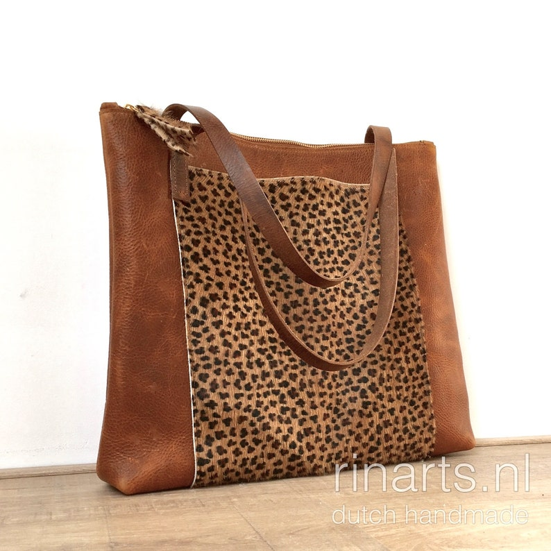 3ef9b1b9145b Cognac leather tote with leopard front pocket. Brown working