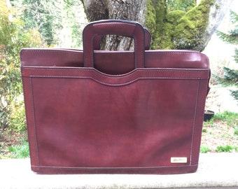 Briefcase, laptop bag, portfolio, vintage 80s leather Oleg Cassini executive brown leather. Looks new.