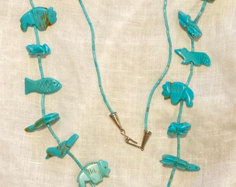 Stunning Zuni style carved turquoise fetish necklace. 17 animals, standing bear in center, buffalo, fox, frog, bird, fish, turtle, tribal!