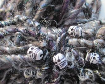 "Handspun art yarn ""SPOOKY"" 50 yards in black, grey, gray, purple, lavender, 10 skulls Halloween, Dia de los Muertos Day of Dead FREE US ship"
