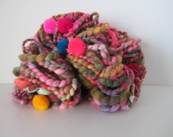 """Handspun art yarn """"This Yarn Has Balls"""" 38 yards w/free U.S. shipping pink purple blue green yellow RED HOT primary colors with 17 pom poms"""