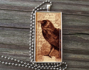 "The RAVEN - POE Glass Tile Necklace inside Metal Framed Bezel Includes 24"" Chain"