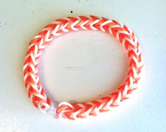GO VOLS!!  This Fishtail Rainbow Loom is Made in Orange And White, the Colors of the University of Tennessee.  Show Us Your School Spirit!